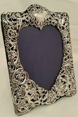 A quality pierced sterling silver photograph frame.London1894.By William Comyns