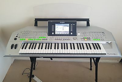Yamaha tyros 2 with stand and interconnect cables.