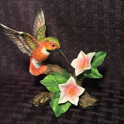 Cute Hummingbird Figurine With Pink And White Flowers