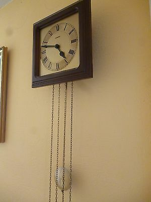 vintage chiming wall clock with pendulum-