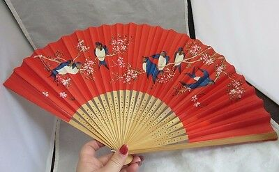 Vintage paper & wood  ladies hand fan. Red with blue birds.