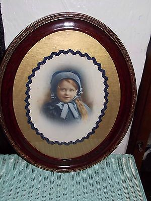 victorian hand tinted photo of a girl in oval fram 36x43cm
