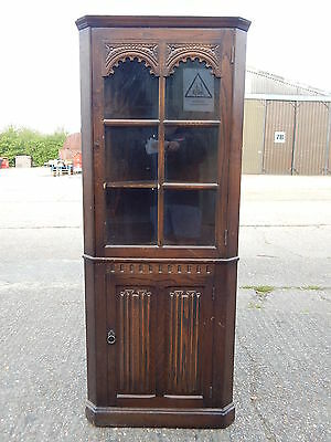 Old Charm style tall oak corner unit display cabinet with glazed beaded door