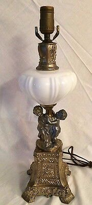 Antique Brass Electric Cherub Lamp with Milk glass Fount