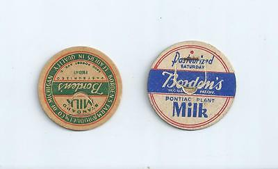 """Two different """"Borden`s""""  from Michigan  milk bottle caps"""