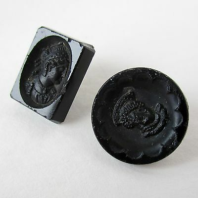 2 Black Glass Buttons With Heads Molded in Relief, 1 Patent Date