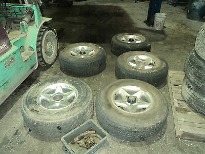 Set of 5 rims/tyres of a Toyota Landcruiser 100 Series