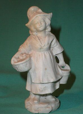 porcelain figure of a girl with a hat and basket and bucket