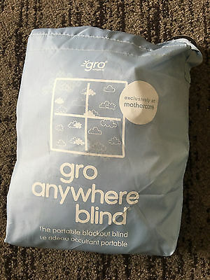 the gro company gro anywhere blackout blind, blue & clouds pattern