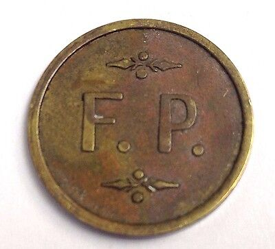 """F.P."" trade or amusement token, vintage 21mm brass, Maverick"