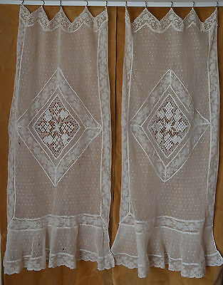 A pair of antique French net and needle lace curtains, imperfect