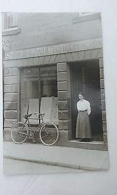 Postcard D & J A Hutcheon Painters Decorators Girl Bicycle storefront