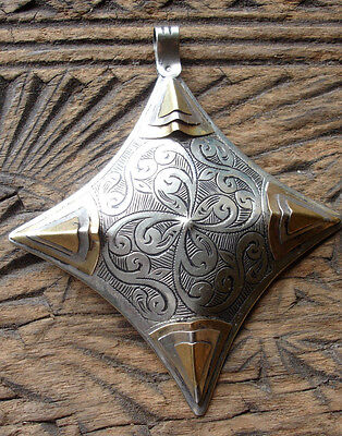 Silver colour with brass hollow Niger amulet diamond pendant