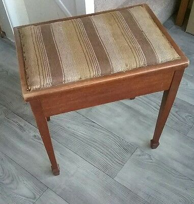 Antique  piano stool with storage.