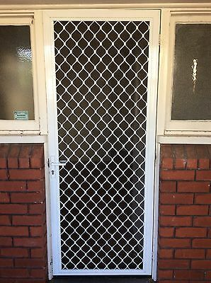 SECURITY DOOR  - WHITE METAL FULL FRONT GRATE, HAS LOCK NO KEY, 176p