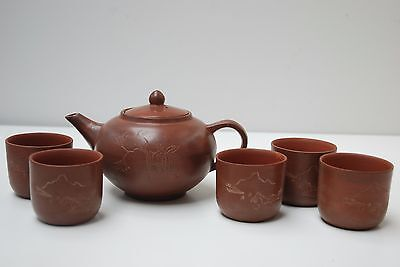 Vintage chinese yixing teapot and tea cups with decoration and calligraphy