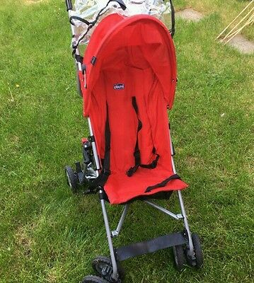 Red stroller buggy pushchair with rainguard cover