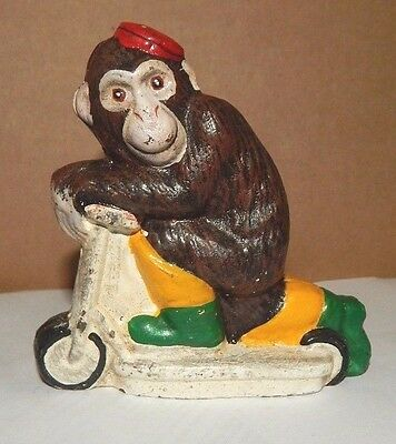 CIRCUS MONKEY RIDING ON SCOOTER CAST IRON COIN SAVINGS BANK Cute!