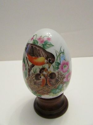 Mama Robin with babies welcoming spring porcelain egg  Four Seasons Series 1980s