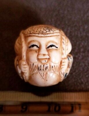 Signed Japanese Hand Carved Ojime Bead Ball - Man with Pack