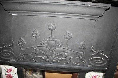 Beautifully tiled and decorative patterned fireplace in cast iron.