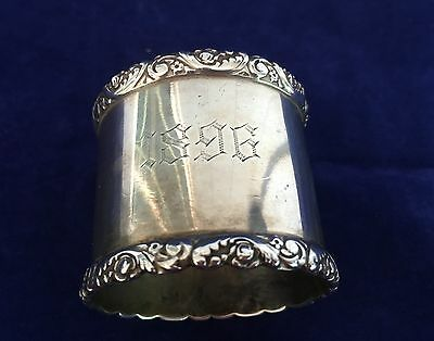 Sterling silver napkin ring with repousse borders, engraved name and 1896
