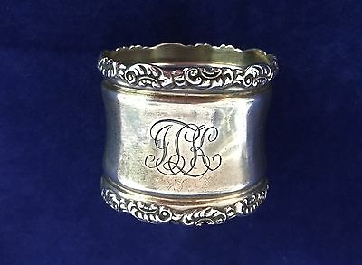 Whiting sterling silver napkin ring with repousse borders, ca. 1900