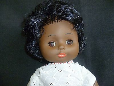 70-80's Hard plastic beautiful brown eyed  with soft black hair  doll 39cm