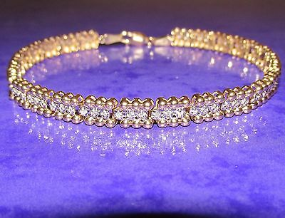 BEAUTIFUL  SECONDHAND QVC 9ct YELLOW GOLD DIAMOND LINE BRACELET 21.0 cm