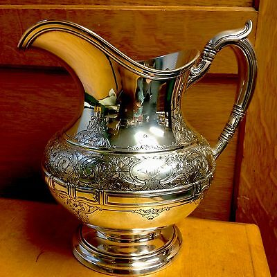 Gorham St. Dunstan chased Sterling Silver Water Pitcher. Monogram. Antique