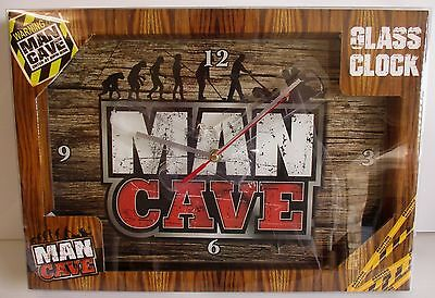 MAN CAVE brand new in presentation box glass design clock, measures 35cm x 23cm