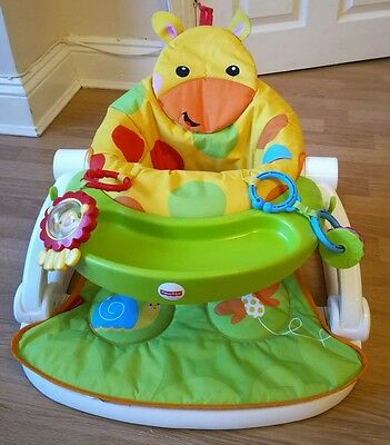 Fisher-Price Giraffe Sit-Me-Up Floor Seat feeding chair with tray and toys