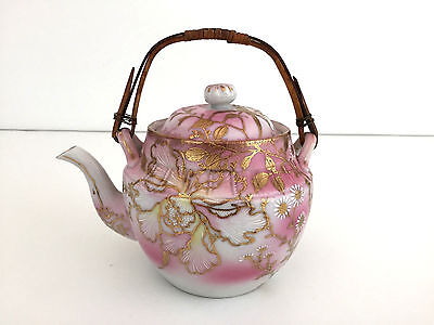 Antique porcelain tea pot, pink and gold with bamboo handle 1900's - 1920's