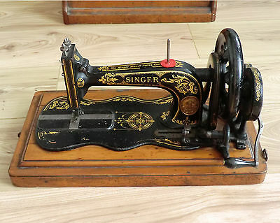 Singer Sewing Machine with original wooden cover & box of accessories