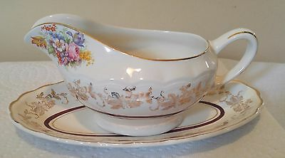 Woods gravy boat & its  platter orleans pattern 22k nice replacement piece