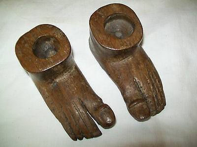 Antique pair of carved wooden feet possibly candle sticks.