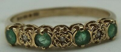 Vintage 9ct gold diamond and emerald band ring. size N.