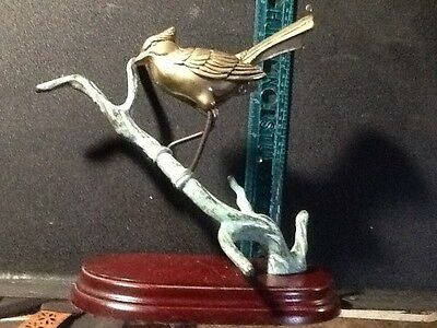Beautiful brass blue jay bird on a branch on a wooden stand, made in Taiwan