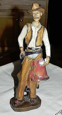 Vintage Carved Resin Standing Cowboy Figurine Holding Saddle Western Collectible