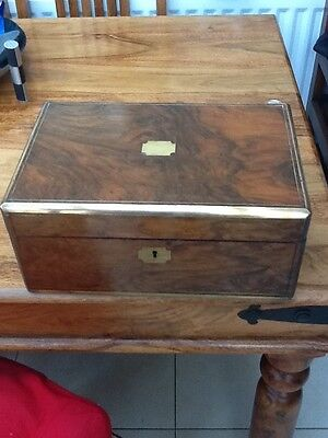 Antique Walnut portable writing desk with brass inlay.
