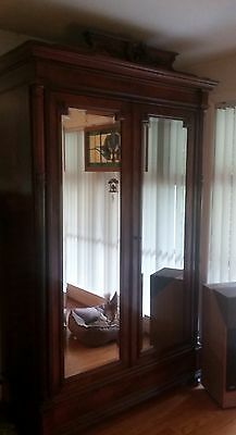 antique  French linen wardrobe with mirrors; can be taken apart for transport;