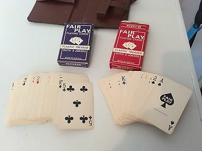 2 packs of playing cards in a case