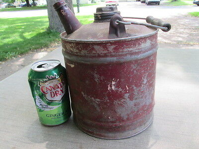 vintage metal gas can with caps.  1 gallon size. wood grip