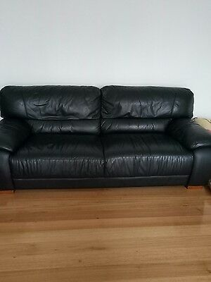 black leather couch/lounge suite 3 seated +4seater