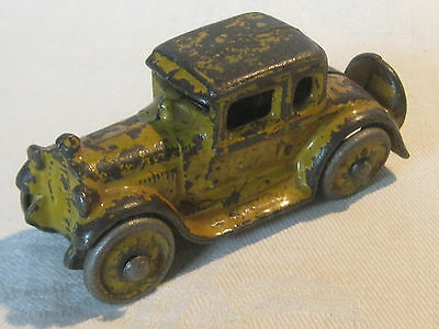 Early vintage cast iron sedan car with spare tire, unmarked