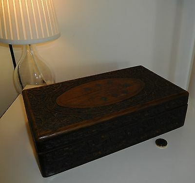 Ornate carved wooden box with inlaid metal work