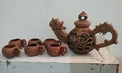 Chinese teapot and tiny cups. dragon carved unknown era