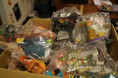 Box Full of 60 Mcdonalds 1990's Happy Meal Toy's  Still in packages