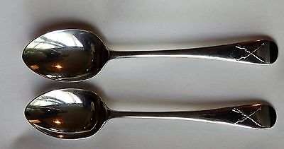 Pair of solid silver novelty teaspoons hallmarked London 1915.