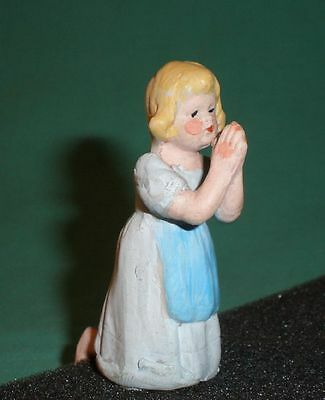 porcelain figurine of a praying girl